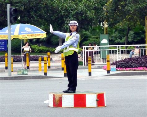 Chinese Policewoman directing traffic at junction   Chris