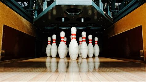 Bowling alley owner dies after getting caught in pin